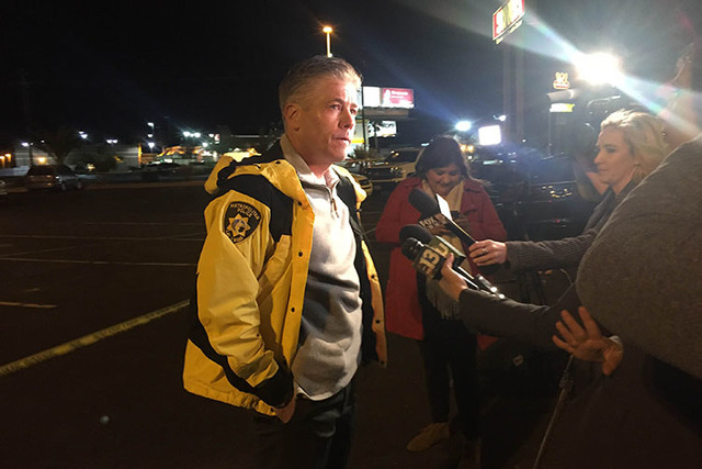 Metro Lt. Dan McGrath speaks to media about a homicide at a strip mall on the southwest corner of Rancho Drive and Cheyenne Avenue Tuesday night. (Rachel Crosby/Las Vegas Review-Journal)