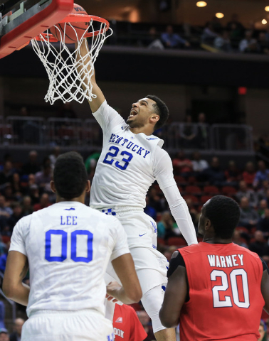 Kentucky's Jamal Murray (23) dunks as Marcus Lee (0) and Stony Brook's Jameel Warney (20) watch, during a first-round men's college basketball game in the NCAA Tournament in Des Moines, Iowa, Thur ...
