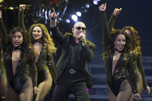 "Pitbull performs during the first of a seven-date mini-residency entitled ""Time of Our Lives"" at The AXIS at Planet Hollywood hotel-casino in Las Vegas Wednesday, Sept. 23, 2015. ..."