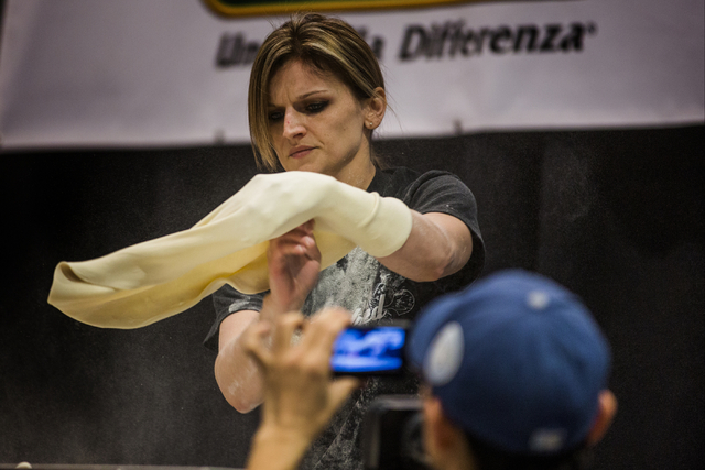 Brittany Saxton, 28, competes in the fastest pizza crust competition during  the Pizza Expo at  the Las Vegas Convention Center on Tuesday, March 8, 2016. Jeff Scheid/Las Vegas Review-Journal Foll ...