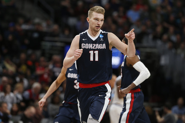 Gonzaga forward Domantas Sabonis gestures after scoring a basket against Seton Hall during the second half of a first-round men's college basketball game Thursday, March 17, 2016, in the NCAA Tour ...