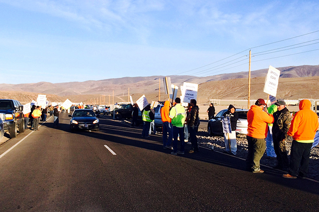 Approximately 300 construction workers walked off the job Monday claiming a contractor has been bringing in lower paid workers from out of state to work on the Tesla Gigafactory east of Reno on Mo ...