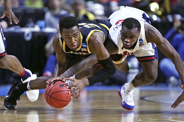 Wichita State forward Markis McDuffie, left, and Arizona guard Kadeem Allen, right, vie for a loose ball during the first half of a first-round game of the NCAA men's college basketball tournament ...