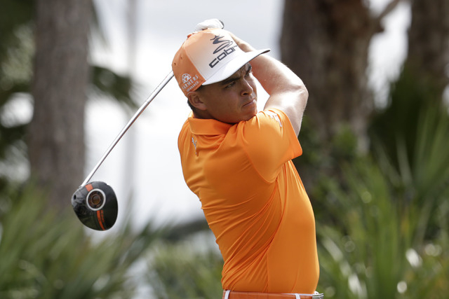 Rickie Fowler tees off from the second hole during the fourth round of the Honda Classic golf tournament, Sunday, Feb. 28, 2016, in Palm Beach Gardens, Fla. (AP Photo/Lynne Sladky)