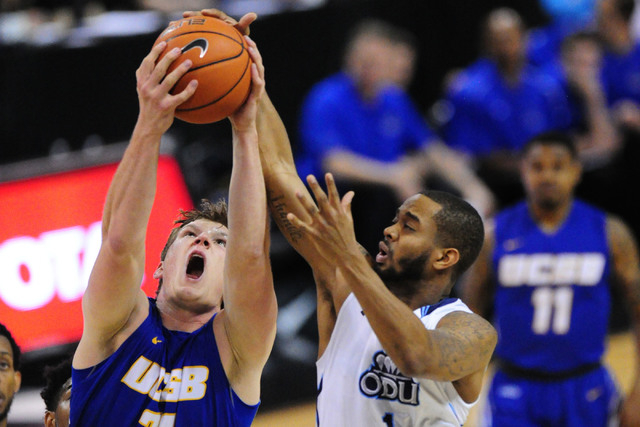 UCSB forward Mitch Brewe, left, pulls down an offensive rebound in front of Old Dominion guard Aaron Bacote in the first half of their NCAA college basketball game at Mandalay Bay Events Center in ...