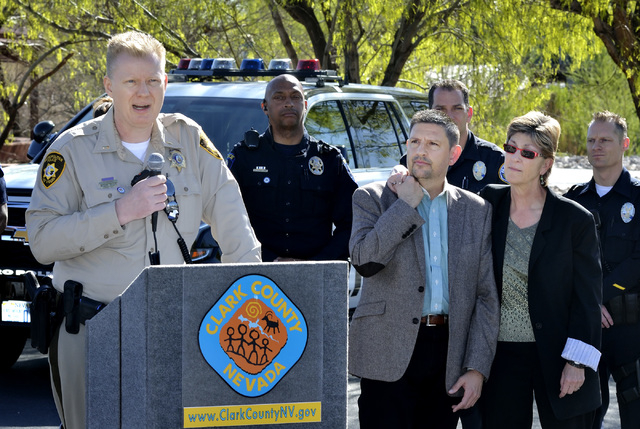 Metro Lt. John Liberty, left, speaks as State Sen. Mark Manendo, center, and Clark County Commissioner Chris Giunchigliani listen during an announcement of an interagency crackdown on crime at the ...