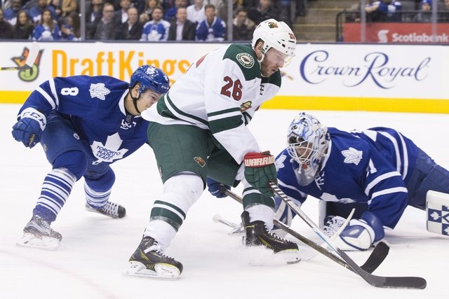 Minnesota Wild's Thomas Vanek (26) tries to get the puck around Toronto Maple Leafs goaltender Garret Sparks, right, as Leafs' Connor Carrick defends during third-period NHL hockey game action in  ...