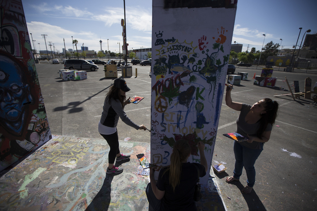 Maral Saccoyah, left, and Liza Rivera paint the Life Cube Project structure at the intersection of 9th Street and Fremont Street on Friday, March 25, 2016, in Las Vegas. Erik Verduzco/Las Vegas Re ...