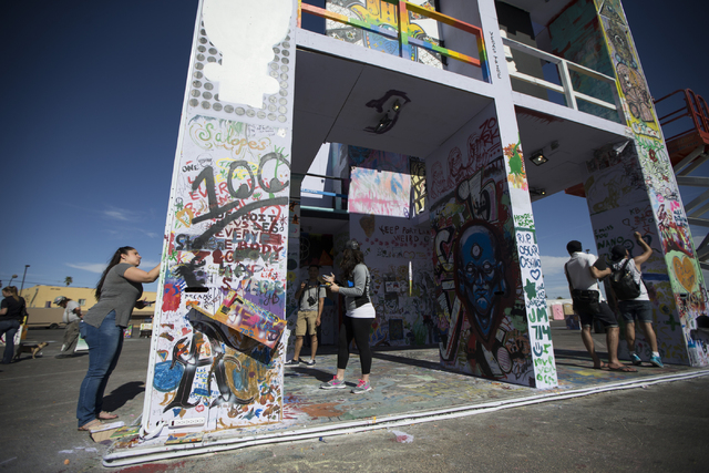 People paint the Life Cube Project structure at the intersection of 9th Street and Fremont Street is seen on Friday, March 25, 2016, in Las Vegas. Erik Verduzco/Las Vegas Review-Journal Follow @Er ...