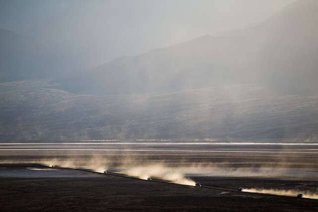 """Cars drive on a dirt road off of Badwater Road in Death Valley National Park, Calif., on Saturday, Feb. 27, 2016. The National Park Service said in a statement that the """"current bloom in Death Val ..."""