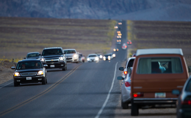"""Traffic moves along Badwater Road in Death Valley National Park, Calif., on Saturday, Feb. 27, 2016. The National Park Service said in a statement that the """"current bloom in Death Valley exceeds a ..."""