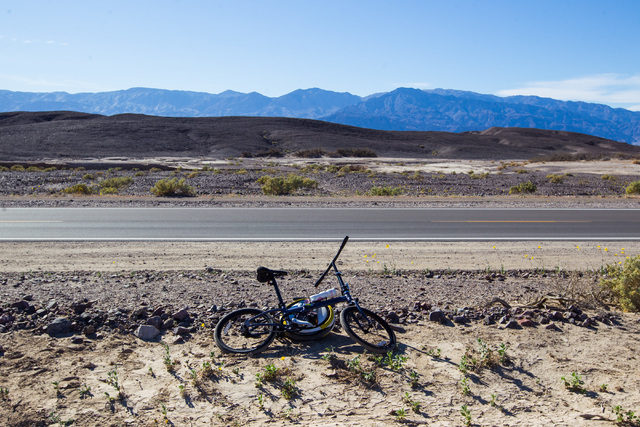 """A lone bike sits along California State Route 190 in Death Valley National Park, Calif. on Saturday, Feb. 27, 2016. The National Park Service said in a statement that the """"current bloom in Death V ..."""
