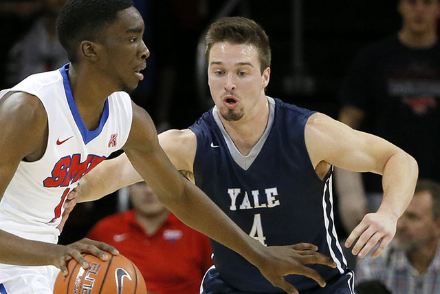 In this Nov. 22, 2015, photo, Yale's Jack Montague, right, defends against SMU guard Shake Milton during an NCAA college basketball game in Dallas. Yale announced on Feb. 24, 2016, that Montague w ...