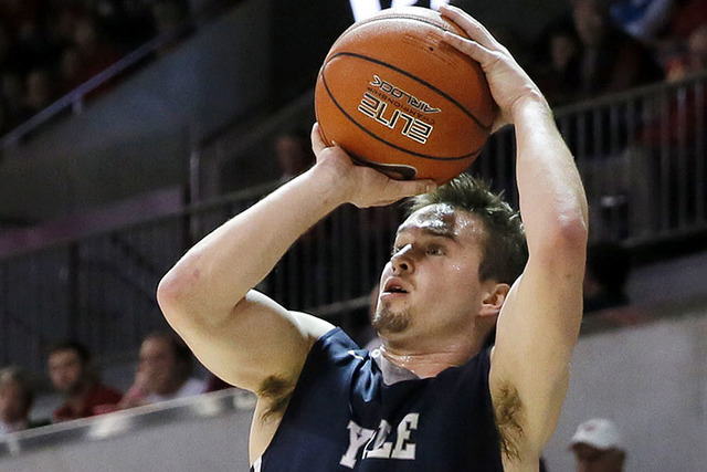 In this Nov. 22, 2015 photo, Yale's Jack Montague attempts a shot during an NCAA college basketball game against SMU in Dallas. Yale announced on Feb. 24, 2016, that Montague was no longer on the  ...