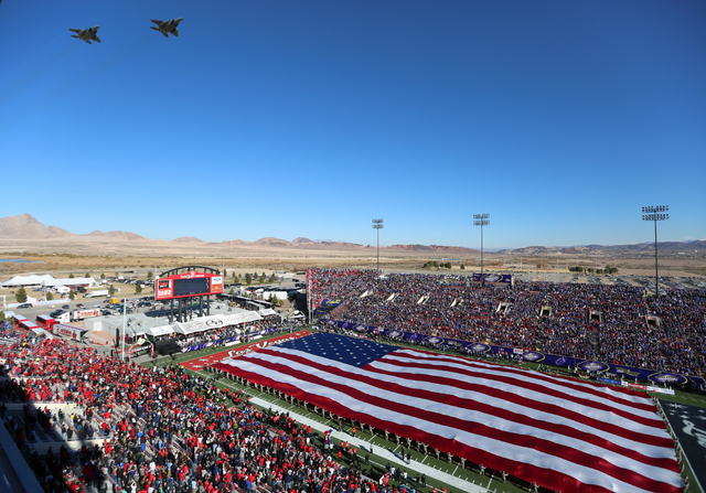 Two F-15s fly over the 2015 Royal Purple Las Vegas Bowl match between the University of Utah and Brigham Young University at Sam Boyd Stadium on Sat, Dec. 19, 2015 in Las Vegas. Brett Le Blanc /La ...