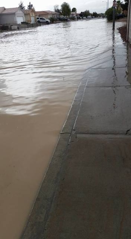 Flooding is shown on Colton Avenue near Cheyenne Avenue and Simmons Street on April 9, 2016. (Courtesy, Katherine DeSilva)