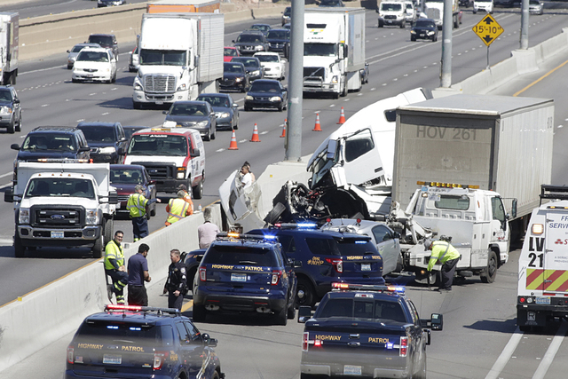 Nevada Highway Patrol officers investigate the scene of a crash involving a semitrailer on northbound Interstate 15 near Tropicana Avenue on Tuesday, April 19, 2016. Bizuayehu Tesfaye/Las Vegas Re ...