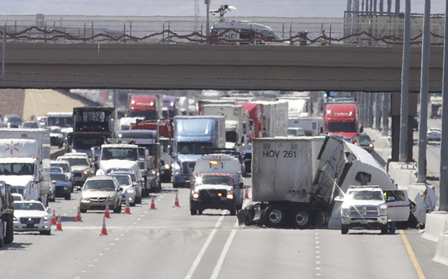 Traffic is backed up on northbound Interstate 15 near Tropicana Avenue after a semitrailer crash, Tuesday, April 19, 2016. (Bizuayehu Tesfaye/Las Vegas Review-Journal Follow @bizutesfaye)
