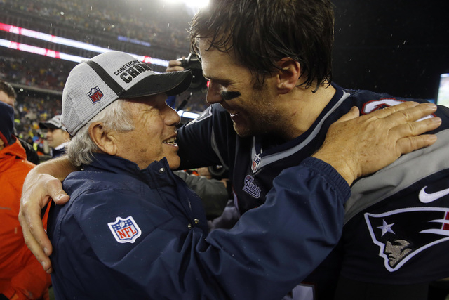 New England Patriots owner Robert Kraft, left, greets quarterback Tom Brady (12) after the AFC Championship Game against the Indianapolis Colts at Gillette Stadium on Jan 18, 2015. (David Butler I ...