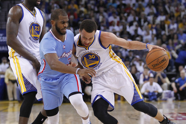 Mar 8, 2015; Oakland, CA, USA; Golden State Warriors guard Stephen Curry (30) dribbles the ball next to Los Angeles Clippers guard Chris Paul (3) in the third quarter at Oracle Arena. The Warriors ...