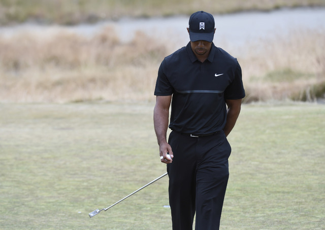 Jun 18, 2015; University Place, WA, USA; Tiger Woods reacts after putting on the 15th green in the first round of the 2015 U.S. Open golf tournament at Chambers Bay. (Michael Madrid/USA Today Sports)