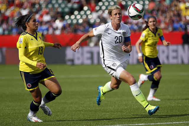 Jun 22, 2015; Edmonton, Alberta, CAN; United States forward Abby Wambach (20) runs down a  ball in the box against Colombia defender Angela Clavijo (13) during the first half in the round of sixte ...