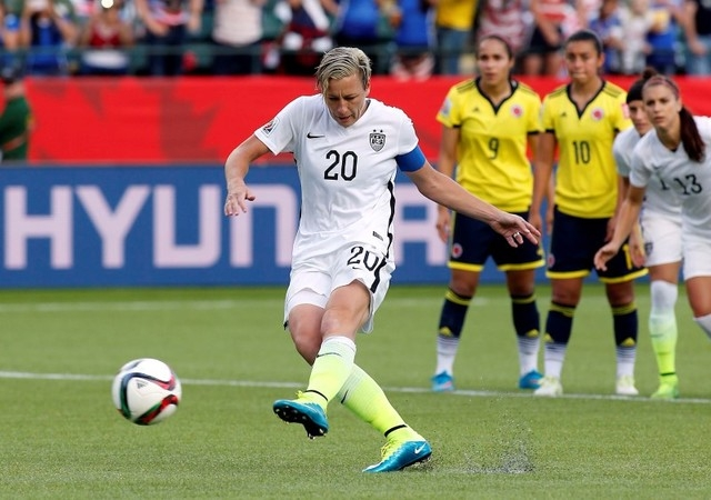 Jun 22, 2015; Edmonton, Alberta, CAN; United States forward Abby Wambach (20) kicks a penalty kick during the second half against the Colombia in the round of sixteen in the FIFA 2015 women's Worl ...