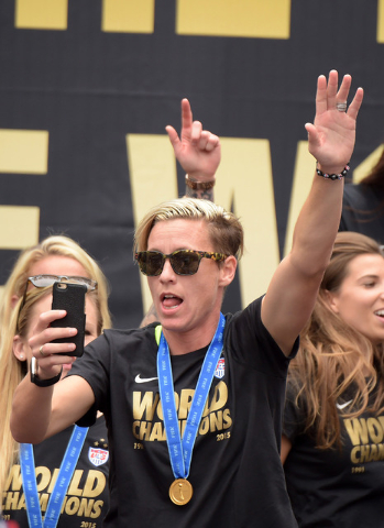 Jul 7, 2015; Los Angeles, CA, USA; United States forward Abby Wambach takes a photo with a cell phone at 2015 Womens World Cup champions celebration at Microsoft Square at L.A. Live. (Kirby Lee/US ...