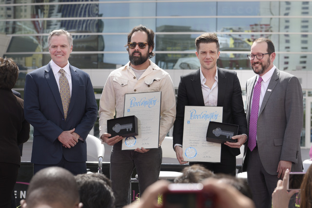 From left, MGM Resorts International Chairman and CEO Jim Murren, Ronnie Vannucci Jr. and Brandon Flowers of The Killers and AEG President and Chief Executive Officer Dan Beckerman pose for a phot ...