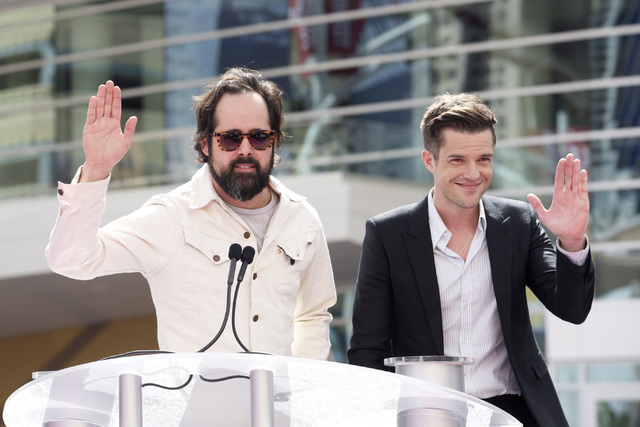 Ronnie Vannucci Jr. and Brandon Flowers of The Killers wave to guests during the grand opening of MGM Resorts  International's T-Mobile Arena Wednesday, April 6, 2016.  Sam Morris/Las Vegas News B ...