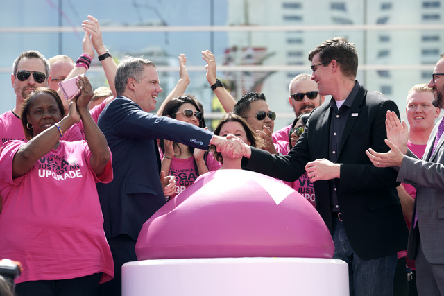 MGM Resorts International President and Chief Executive Officer Jim Murren and T-Mobile Chief Marketing Officer Andrew Sherrard shake hands during the grand opening of MGM Resorts  International's ...