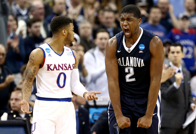 Mar 26, 2016; Louisville, KY, USA; Villanova Wildcats forward Kris Jenkins (2) reacts to a play against the Kansas Jayhawks during the first half of the south regional final of the NCAA Tournament ...