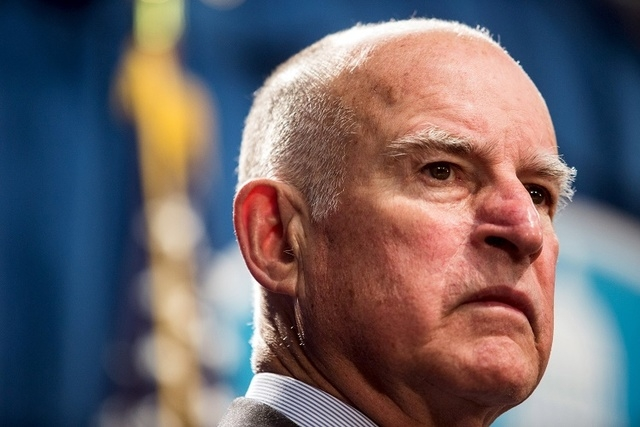 California Governor Jerry Brown looks on during a news conference at the State Capitol in Sacramento, California in this file photo taken March 19, 2015.  (REUTERS/Max Whittaker/Files)