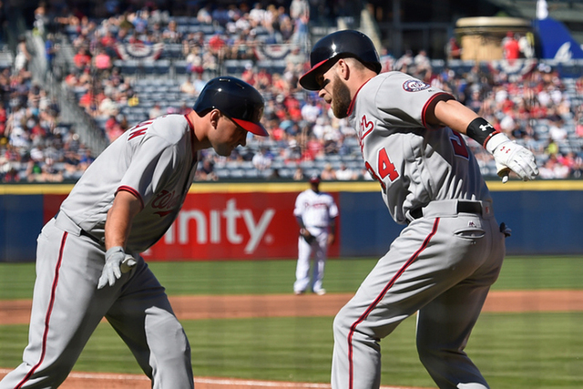 Apr 4, 2016; Atlanta, GA, USA; Washington Nationals right fielder Bryce Harper (34) reacts with first baseman Ryan Zimmerman (11) after hitting a home run against the Atlanta Braves during the fir ...