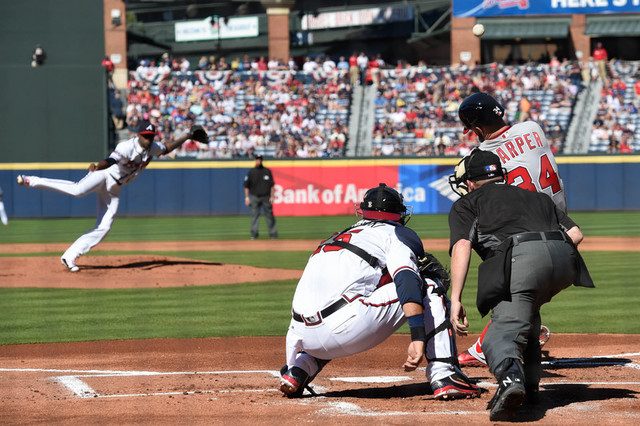 Apr 4, 2016; Atlanta, GA, USA; Washington Nationals right fielder Bryce Harper (34) hits a home run against Atlanta Braves starting pitcher Julio Teheran (49) during the first inning at Turner Fie ...