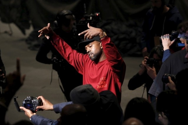 """Kanye West dances during his Yeezy Season 3 Collection presentation and listening party for the """"The Life of Pablo"""" album during New York Fashion Week February 11, 2016. (Andrew Kelly/Reuters)"""