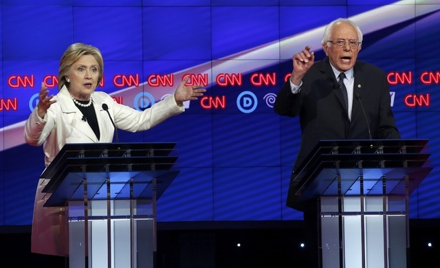 Hillary Clinton and Bernie Sanders speak simultaneously during a Democratic debate on April 14, 2016. (Lucas Jackson/Reuters)