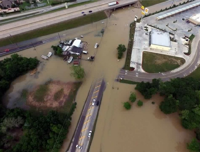 Flood waters cover the area of FM 1463 at IH-10 in Fort Bend County, Texas, U.S. April 19, 2016. (Texas DOT-Houston/Handout via Reuters)