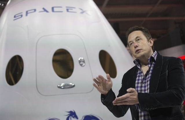 SpaceX CEO Elon Musk speaks after unveiling the Dragon V2 spacecraft in Hawthorne, California May 29, 2014. Space Exploration Technologies announced April 27, 2016, it will send uncrewed Dragon sp ...