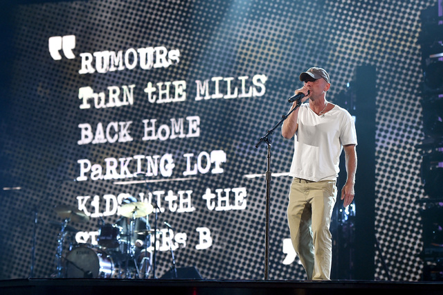 Singer Kenny Chesney rehearses onstage during the 51st Academy of Country Music Awards at MGM Grand Garden Arena. (Kevin Winter/Getty Images)