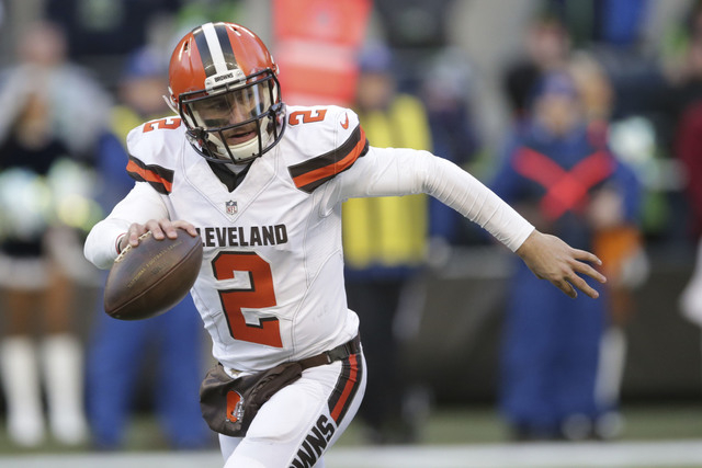 In this Sunday, Dec. 20, 2015 file photo, Cleveland Browns quarterback Johnny Manziel looks to pass against the Seattle Seahawks in the second half of an NFL football game in Seattle. The Browns h ...
