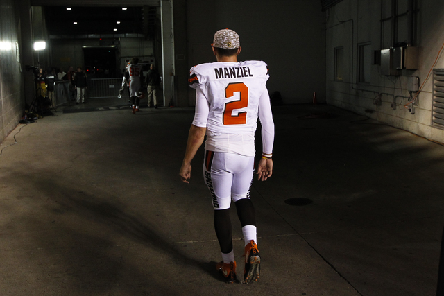 In this Nov. 5, 2015, file photo, Cleveland Browns quarterback Johnny Manziel walks off the field after an 31-10 loss to the Cincinnati Bengals, in Cincinnati. (Frank Victores, File/AP)