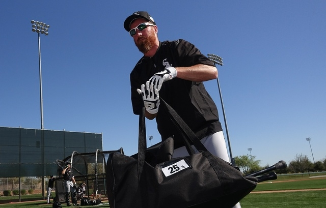 In this Feb. 26, 2016, file photo, Chicago White Sox's Adam LaRoche picks up his gear after taking live batting practice during a spring training baseball workout in Glendale, Ariz. LaRoche surpri ...