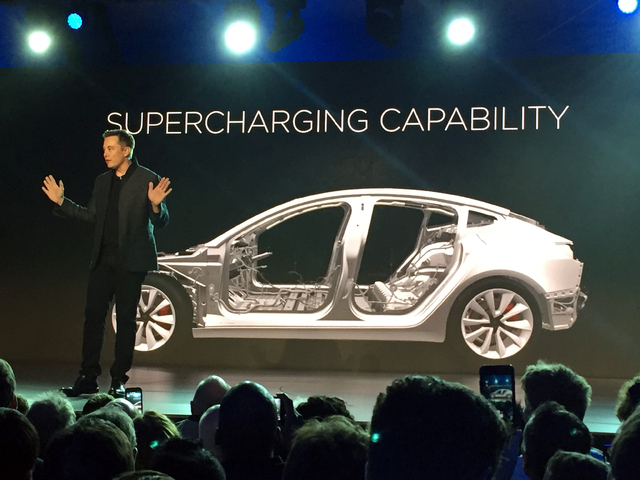 Tesla Motors Inc. CEO Elon Musk speaks at the unveiling of the Model 3 at the Tesla Motors design studio Thursday, March 31, 2016, in Hawthorne, Calif. The promise of an affordable electric car fr ...