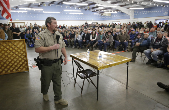 In this Jan. 6, 2016, file photo, Harney County Sheriff David Ward leads a community meeting at the Harney County fairgrounds in Burns, Ore. (Rick Bowmer, File/AP)