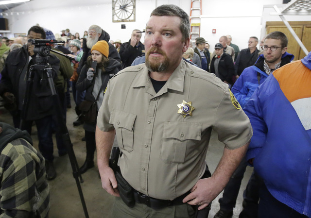 In this Jan. 6, 2016 file photo, Harney County Sheriff David Ward arrives at a community meeting at the Harney County fairgrounds in Burns, Ore. (Rick Bowmer, File/AP)