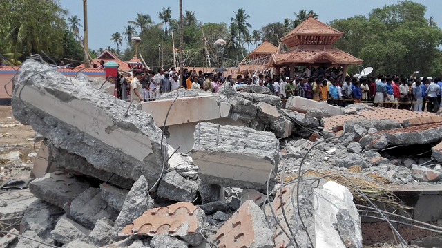 A view of a collapsed building after a massive fire broke out during a fireworks display at the Puttingal temple complex in Paravoor village, north of Thiruvananthapuram, southern Kerala state, In ...