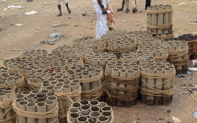 Fire cracker shells are kept stacked near the spot where a massive fire broke out during a fireworks display at the Puttingal temple complex in Paravoor village, Kollam district, southern Kerala s ...