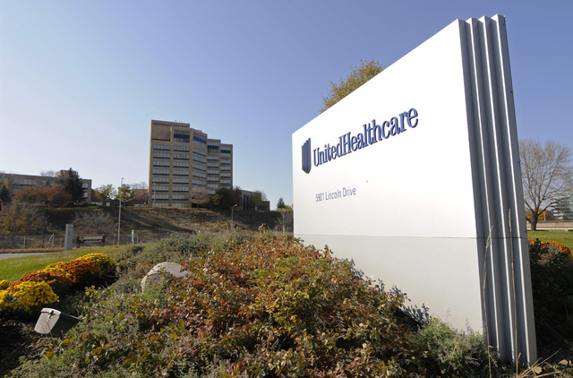 This Oct. 16, 2012, photo, shows a portion of the UnitedHealth Group Inc.'s campus in Minnetonka, Minn. U.S. health insurer UnitedHealth Group Inc. on Tuesday said it would largely exit the Obamac ...
