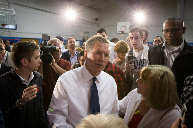 Republican presidential candidate, Ohio Gov. John Kasich meets with audience members after speaking during a campaign stop at Solvay Youth Center, Monday, April 18, 2016, in Syracuse, N.Y. (AP Pho ...